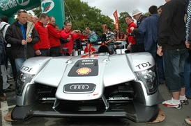 An Audi R15 TDI during scrutineering.  Michelin decals are placed on one of the protested aerodynamic elements.