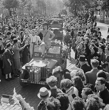 Cheering crowds greet British troops entering Brussels, 1944