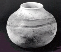 Before the invention of pottery in Western Asia, during the Pre-Pottery Neolithic: jar in calcite alabaster, Syria, late 8th millennium BC.