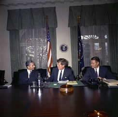 Mohammad Reza Pahlavi, Shah of Iran, Kennedy, and U.S. Defense Secretary Robert McNamara in the White House Cabinet Room on April 13, 1962