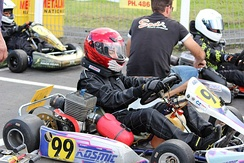 A driver with a 2008 Kosmic TS28 on the grid at KartSport Mt Wellington, New Zealand