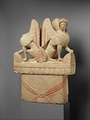 Limestone funerary stele (shaft) surmounted by two sphinxes Greece 5th century BCE.