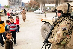 An American soldier standing with children at Freedom Circle (2011)