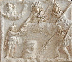 Sol and Mithras banqueting with Luna and the twin divinities Cautes and Cautopates, his attendants (side B of a double-sided Roman marble relief, 2nd or 3rd century CE)