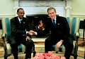 One of many hand-shake photos in front of the fireplace. President George W. Bush sitting to the viewer's right, the guest (Paul Kagame, President of Rwanda) to the left. One of the rare images where there is fire in the fireplace. March 2003.