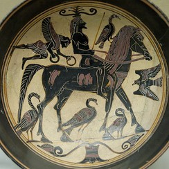 Horseman with a scrolling tendril growing from his head, under the feet of the horse the separated second segment, cup tondo of a name vase by the Rider Painter, c. 550/530 BC, now in the British Museum
