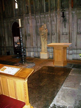 Location of St Cuthbert's tomb and reburial in Durham Cathedral; behind is a damaged statue of St Cuthbert, holding the head of the king St Oswald (whose head was reburied with Cuthbert)
