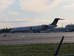 United Express CRJ700 taxiing off the runway at MHT from IAD (Dulles)