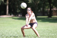 A player making a forearm pass or bump