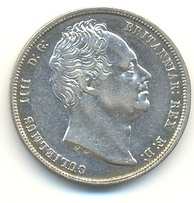 Half-Crown of William IV, 1836. The inscription reads GULIELMUS IIII D(EI) G(RATIA) BRITANNIAR(UM) REX F(IDEI) D(EFENSOR) (William IV by the Grace of God King of the Britains, Defender of the Faith)