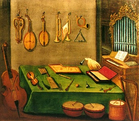 Late 18th-century painting of instruments from the school of Zlatá Koruna. On the wall are several lutes and brass instruments. On the left is a cello-type instrument. In the middle are several drums. On the right is a small pipe organ.