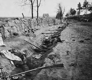 Confederate dead behind the stone wall of Marye's Heights, Fredericksburg, Virginia, killed during the Chancellorsville campaign (the Second Battle of Fredericksburg), May 1863. Photograph by A.J. Russell.