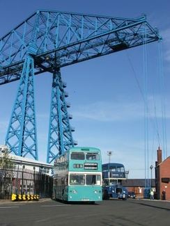 Preserved Teesside Municipal Transport L544, a 1972 Northern Counties bodied Daimler Fleetline CRL6, with Dennis Loline 99 in dark blue Middlesbrough Corporation livery at Middlesbrough Transporter Bridge.