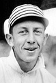 Black and white photo of Eddie Collins in close up, wearing a 1911 Philadelphia Athletics cap