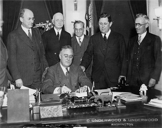 President Franklin Delano Roosevelt signs the bill into law in 1934.