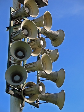Horn loudspeakers are often used to broadcast sound in outdoor locations