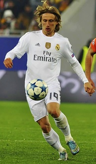 Real Madrid's jersey (worn by Luka Modrić in 2015) is manufactured by Adidas, with Emirates the shirt sponsor