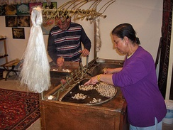 Silk filaments being unravelled from silk cocoons, Cappadocia, Turkey, 2007.