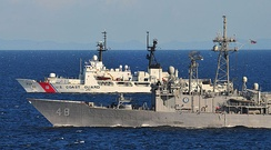 USS Vandegrift (FFG 48) and USCGC Mellon (WHEC-717) cruising side by side in the Java Sea on May 28, 2010