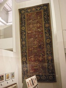 Mughal carpet with inwoven Fremlin family crest, Victoria and Albert Museum