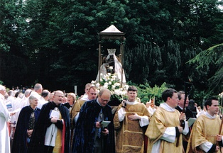 Anglicans processing their image during their National Pilgrimage to Walsingham within the grounds of the ruined abbey, May 2003.