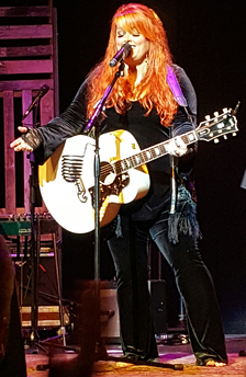 Wynonna Judd in July 2016 performing with her band The Big Noise