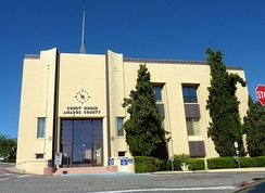 The Amador County Courthouse consists of two buildings, the second courthouse (built 1864) and the Hall of Records (1893), that were enclosed and combined in 1939 with an Art Deco exterior.[6]