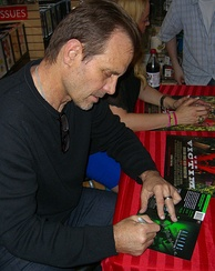 Michael Biehn signing a copy of the film's DVD cover at an August 2012 Midtown Comics appearance