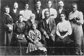 The leaders of the Apostolic Faith Mission. Seymour is front row, second from the right; Jennie is back row, third from left.