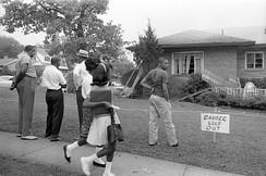 Birmingham, Alabama, residents viewing the bomb-damaged home of Arthur Shores, NAACP attorney and Alpha Phi Alpha member, on September 5, 1963. The bomb exploded the previous day.