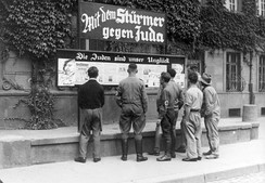 Public reading of the anti-Semitic weekly newspaper Der Stürmer, Worms, Germany, 1935