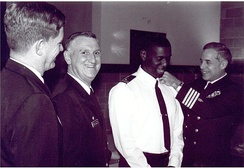 Frocking ceremony for U.S. Navy's first Muslim chaplain, when Navy (rabbi) Chaplain Arnold Resnicoff attaches new shoulder boards with Muslim Chaplain crescent insignia to uniform of Imam Monje Malak Abd al-Muta Noel Jr, 1996