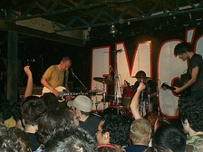 Fugazi performing at Emo's in 2002