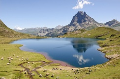 Lac Gentau reflecting the Pic du Midi d'Ossau (Pyrénées, France). Lacustrine environments only make up a small portion of the total depositional environments.