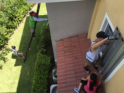Residents in Doral installing hurricane shutters in advance of the storm