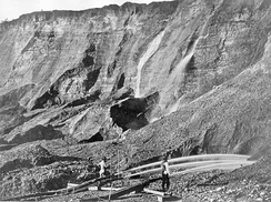 Gold miners excavate an eroded bluff with jets of water at a placer mine in Dutch Flat, California sometime between 1857 and 1870.