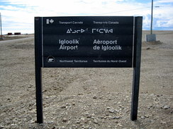Entrance sign to Igloolik Airport, with text in English, French, and Inuktitut[note 1]