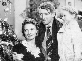 George Bailey (James Stewart), Mary Bailey (Donna Reed), and their youngest daughter Zuzu (Karolyn Grimes).