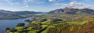 Skiddaw mountain, the town of Keswick, Cumbria and Derwent Water seen from Walla Crag, Lake District, England.