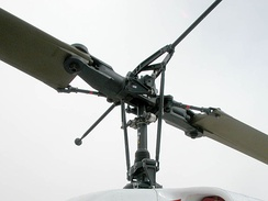 A teetering rotor system with a weighted flybar device