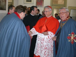 Knights in the robes of the order greeting Cardinal Castrillón, 2009