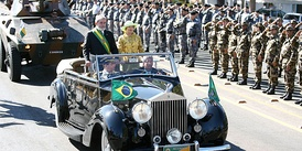 Former President Lula, with his wife Marisa Letícia, reviews troops during Independence Day military parade in Brasília, Brazil.
