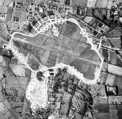 25 January 1944 aerial photograph of the RAF Watton airfield and the USAAF 3d Strategic Air Depot. The bomb dump to the right of the perimeter track; the 3d SAD is at the bottom (south) of the image.