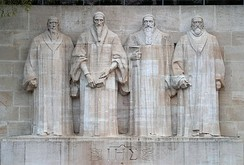 The Reformation Wall in Geneva, Switzerland with statues to William Farel, John Calvin, Theodore Beza, and John Knox, the founders of the Reformed theological tradition to which the PCA subscribes