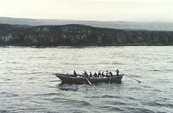 Men rowing a baidara (large skin boat)