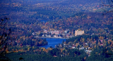The village of Saranac Lake, with Lake Flower below and Lake Colby above, from Scarface Mountain to the Southeast.