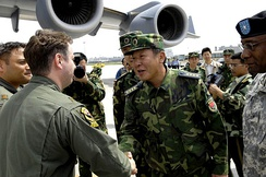Senior Capt. Guan Youfei greeted the first of two U.S. aircrews delivering earthquake relief supplies