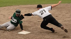A player trying to avoid a tag at third base.