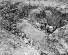 Dead German soldiers in a captured German trench near Ginchy, August 1916