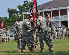 MAJ Steven M. Finney (left of center) accepts the battalion colors from the Louisiana Adjutant General, MG Bennett C. Landreneau (right of center) becoming the battalion commander in June 2011